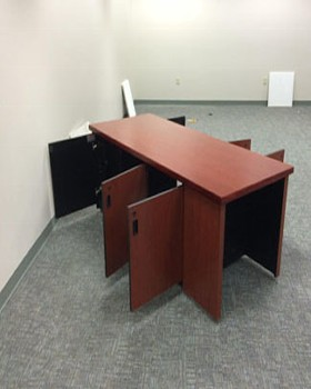 Large room control credenza with knee-hole for operator. Access doors on both sides