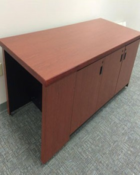 Room control credenza with knee-hole for operator. Access doors on both sides. On casters for portability.