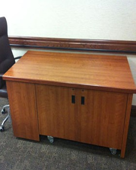 Large room control credenza with knee-hole for operator. On casters for easy re-location.