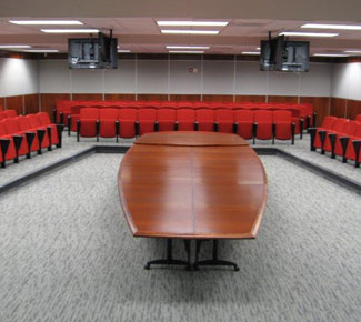 Transformable Boat-shaped table in a spacious conference center - CLOSED for generic meeting.